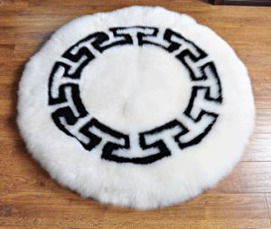 Large Size Round Sheepskin Floor Area Carpet in Football Pattern pictures & photos