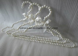 White Pearl Triangle with Concave Bow Clothes Rack ABS Plastic Hangers Clothing Bead Hangers (M-X3547) pictures & photos
