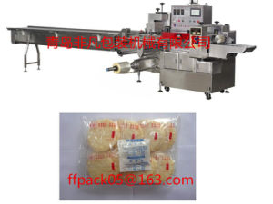 Full- Automatic Servo Motor Flow Packing/ Packaging Machine for Snow Cake pictures & photos