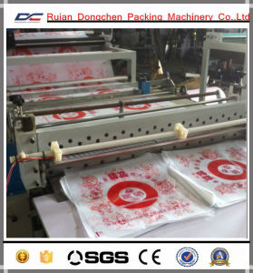 Economic Type Cake or Bread Oil Paper Roll to Sheets Cutting Machine (DC-HQ) pictures & photos