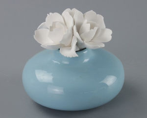 Hot Sale Ceramic Perfume Bottle with Flower Cap pictures & photos