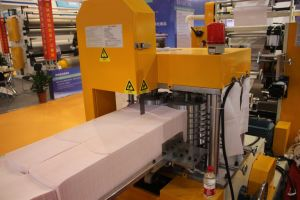 Automatic on The Glue and Color Embossing Lunch Napkin Folding Machine pictures & photos