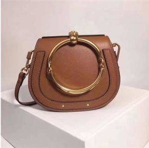 2017 New Metallic Ring Handle Hand Bag PU Trendy Saddle Leisure Shoulder Bag Hcy-5053 pictures & photos