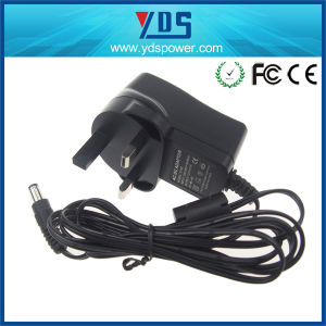 12V 1A UK Wall Plug in Adapter pictures & photos