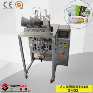 China Factory Double Heads Face Mask Filling Sealing Packing Machine pictures & photos