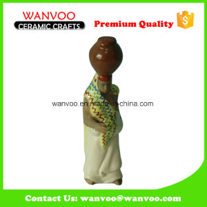 Custom Polished Glazed Ceramic Character Statue with Bottle Upon Head pictures & photos