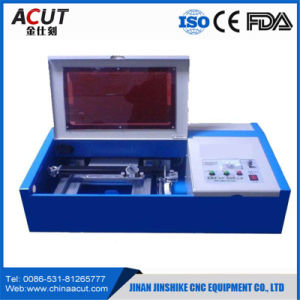 Mini Stamp Engraving CNC Router Machine with Ce pictures & photos