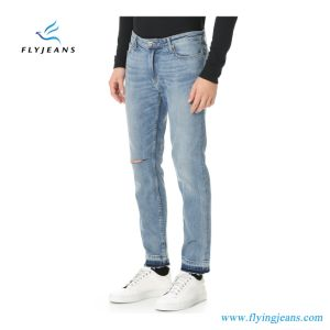Men′s Whiskered Teared Stonewashed Denim Jeans with Frayed Leg Openings pictures & photos