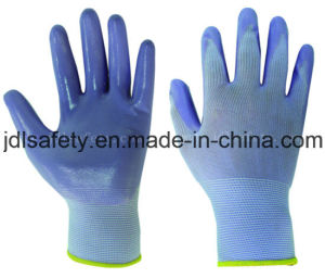 Nylon Knitted Work Glove with Smooth Nitrile Dipping (N1569C) pictures & photos
