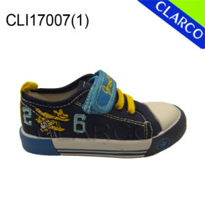 Children Fashion Sports Running Vulcanized Canvas Shoes pictures & photos