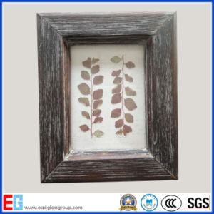 Wooden Photo Frame / Wood Picture Frame pictures & photos
