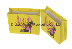 Matte Shopping Paper Bag/Gift Paper Bag with Ribbon Handle pictures & photos