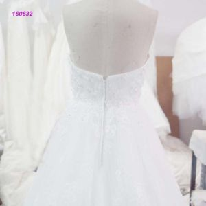 160632 Backless A Line Wedding Dress with Lace Throughout The Dress pictures & photos