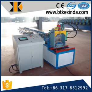 Kxd Cold Metal Roller Shutter Doors Roll Forming Machine pictures & photos