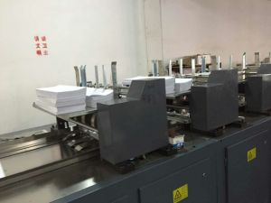 Full Automatic Primary School Diary Notebook Student Exercise Book Production Line pictures & photos