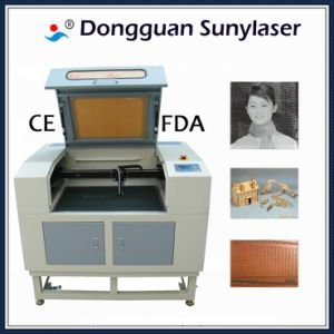 Fast Speed Laser Engraving Machine for Nonmetals with CE FDA pictures & photos