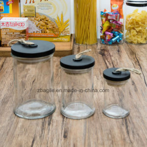 Factory Wholesale High Quality Nature Wood Lid Food Candy Storage Glass Jar (100028) pictures & photos