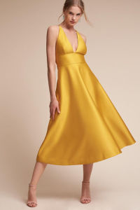 Plunging Halter Neckline Balances a High Fitted Waist Evening Dress pictures & photos