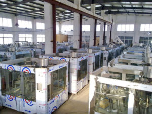 Full Automatic Bottle Milk Aluminum Foil Filling and Sealing Machine pictures & photos