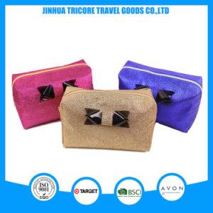 2015 Whole Sale Beautiful Shinny PU Cosmetic Bag with Bowknit pictures & photos