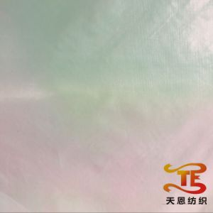 New Fashion Style Pearl Like Colorful Reflection Polyester Fabric for Jackets and Stage Uniform pictures & photos