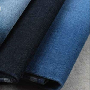 Wholesale Indigo Yarn Denim Fabric for Pants pictures & photos