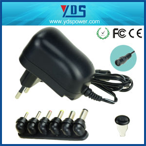 Wall Mount Universal AC DC Power Supply 12W Switching Adapter pictures & photos
