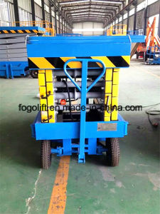 Manual Towable Scissor Lift Mobile Lift Platform in Stock pictures & photos
