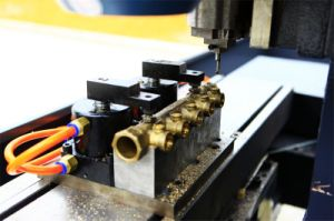 Drilling and Tapping CNC Machine for Water Segergator (DKZG01A) pictures & photos
