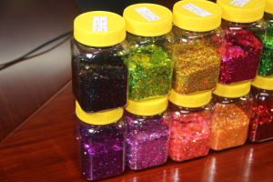 Large Quantities of Spring Glitter Powder Decorated The Clothes pictures & photos