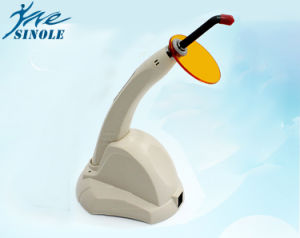 Dental LED Curing Light with Charger Seat Tester Dental Curing Light pictures & photos