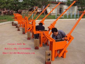 Best-Selling Low Cost Interlocking Brick Making Machine of Qmr2-40 High Quality Cement Brick Making Machine Production Line in Kenya pictures & photos