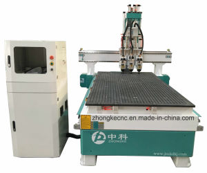 Three Heads Automatic Tool Changer Wood CNC Router Machine pictures & photos