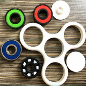 Colorful Hand Spinner with Copper Cage Fidget Spinner pictures & photos