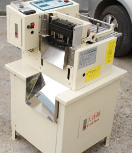 Automatic Hook Cutting Machine for Hook & Loop Tape pictures & photos