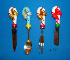 Stainless Steel Spoon with Polyresin Handle pictures & photos