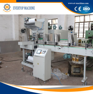 Semi-Auto Film Wrapping Packaging Machine pictures & photos