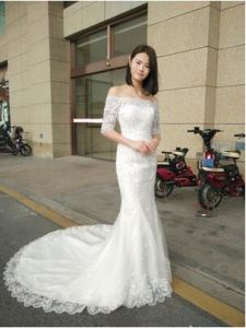 Gormous off Shoulder Lace Sequins Half-Sleeves Mermaid Fishtail Wedding Dress pictures & photos