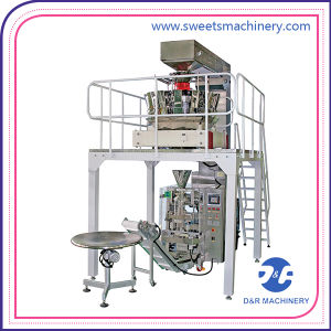 Automatic Vertical Stand-up Quad-Seal Packing Machine pictures & photos