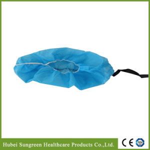 Disposable Nonwoven ESD Shoe Cover with Conductive Strip pictures & photos