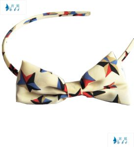 Cream Color Chiffon with Star Printings Bowknot Headband pictures & photos