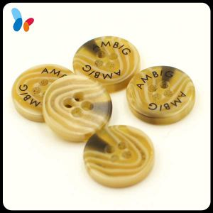 Laser Logo Plastic Four Holes Button Polyester Resin Button for Shirt pictures & photos