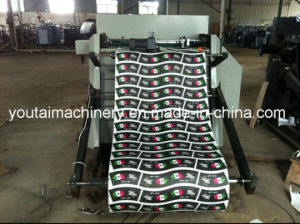 Full Automatic Roll Paper Punching Machine pictures & photos