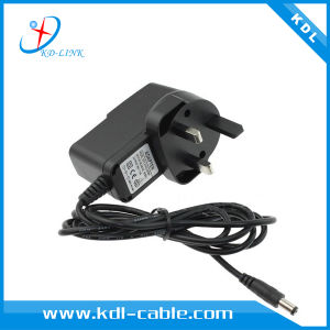 UK Plug Adapter Ce & RoHS Certified 12V 0.7A Power Adapter