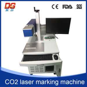 Hot Style 60W CO2 Laser Marking Machine for Glass pictures & photos