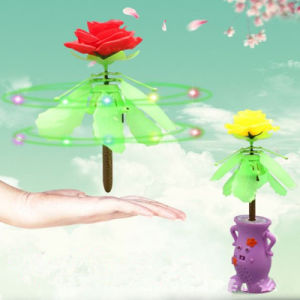 Hand Induced Spinning Rose Helicopter Toy pictures & photos