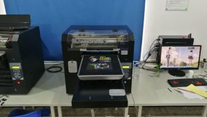 2017 High Quality A3 LED UV Digital Semi-Automatic T-Shirt Printing Machine pictures & photos