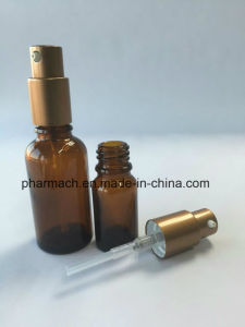 Amber Essential Oil Glass Bottle with Emulsion Gold Aluminum Pump pictures & photos