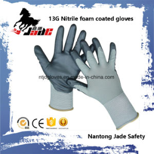 13G Nitrile Foam Coated Work Glove pictures & photos