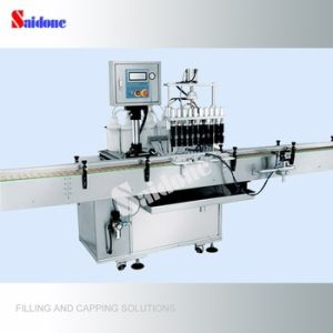 Worldwide Selling 4 Heads Vacuum Filling Machine pictures & photos